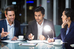 Group of businesspeople discussing over digital tablet Royalty Free Stock Image