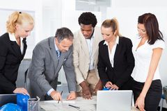 Group of businesspeople discussing together Royalty Free Stock Photo