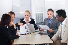 Group of businesspeople discussing together. Group Of Multi Ethnic Businesspeople Discussing Together In Office royalty free stock photography