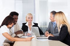 Group of businesspeople discussing together Royalty Free Stock Image