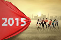 Group of businesspeople drag number 2015 Royalty Free Stock Image