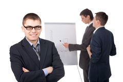 Group of businesspeople and flipchart Royalty Free Stock Images