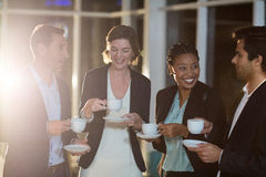 Group of businesspeople having coffee during break Stock Image
