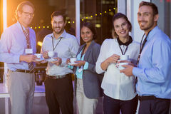Group of businesspeople having coffee during break Royalty Free Stock Photos