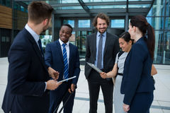 Group of businesspeople having a conversation Stock Photo