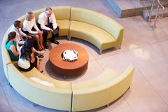 Group Of Businesspeople Having Meeting In Office Lobby Royalty Free Stock Photography