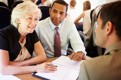 Group Of Businesspeople Having Meeting On Train Royalty Free Stock Images