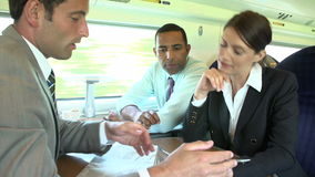 Group Of Businesspeople Having Meeting On Train Royalty Free Stock Photo