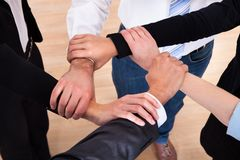 Group Of Businesspeople Holding Wrist Stock Photo