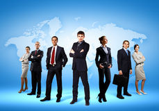 Group of businesspeople. Image of businesspeople standing against world map background stock image