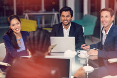 Group of businesspeople interacting with each other in meeting. Group of businesspeople interacting with each other at meeting in office Royalty Free Stock Photo