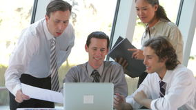 Group Of Businesspeople With Laptop Having Meeting stock video
