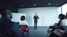 Group of businesspeople listening to a lecture stock video footage