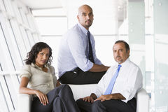 Group of businesspeople in lobby Royalty Free Stock Photo