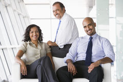 Group of businesspeople in lobby Stock Images