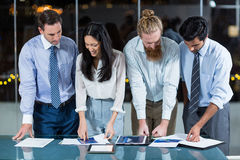 Group of businesspeople looking at document Stock Image