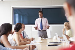 Group Of Businesspeople Meeting Around Boardroom Table Stock Photography