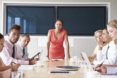 Group Of Businesspeople Meeting Around Boardroom Table Stock Photo