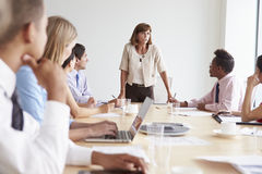 Group Of Businesspeople Meeting Around Boardroom Table Royalty Free Stock Photography