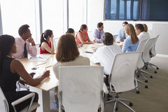 Group Of Businesspeople Meeting Around Boardroom Table Stock Image