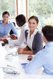 Group Of Businesspeople Meeting Around Boardroom Table Royalty Free Stock Photos