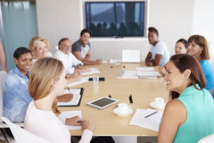 Group Of Businesspeople Meeting In Boardroom Stock Image