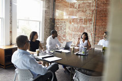 Group Of Businesspeople Meeting In Modern Boardroom Stock Photo