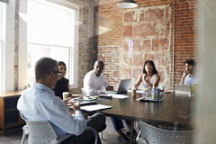 Group Of Businesspeople Meeting In Modern Boardroom Stock Photos