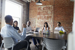 Group Of Businesspeople Meeting In Modern Boardroom Royalty Free Stock Image