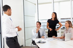 Group Of Businesspeople Meeting In Office Stock Image