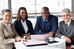 Group businesspeople office. Group of happy businesspeople sitting in office Royalty Free Stock Photo