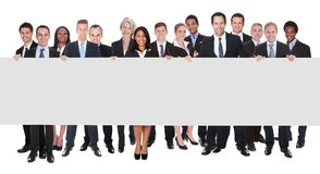 Group of businesspeople with placard Royalty Free Stock Image