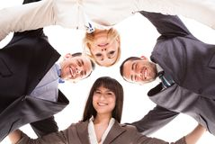 Group of businesspeople putting heads together Royalty Free Stock Images