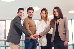 Group of businesspeople putting their hands on top Royalty Free Stock Image
