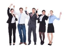 Group of businesspeople raising hand stock image