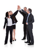 Group Of Businesspeople Raising Hand Together. Over White Background Royalty Free Stock Photo