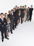 Group Of Businesspeople In Row. Full length group portrait of multiethnic businesspeople in a row against white background royalty free stock photography