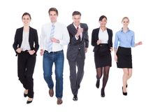 Group of businesspeople running Stock Photos