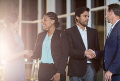 Group of businesspeople shaking hands with each other Stock Photography