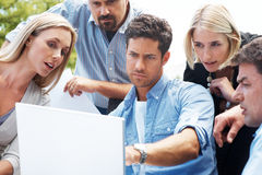 Group of businesspeople sharing ideas Stock Photos