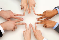 Group of businesspeople showing v-sign Stock Photo