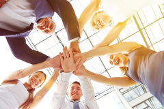 Group of businesspeople stacking hands Stock Photos