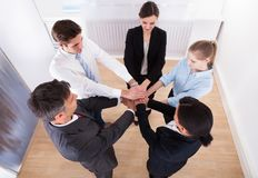 Group Of Businesspeople Stacking Their Hands Stock Photos