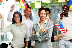 Group of businesspeople standing with flags Royalty Free Stock Images