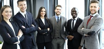 Group of businesspeople standing together in office. stock photos