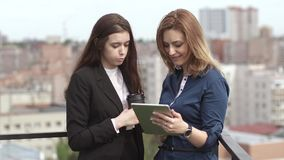 Group of businesspeople talking and show each other the information on the screen of the tablet PC. twogirls hold a stock footage