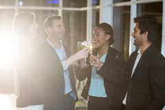 Group of businesspeople toasting glasses of champagne. In the office Royalty Free Stock Photos