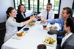 Group of businesspeople toasting wine glass during business lunch meeting Stock Photography