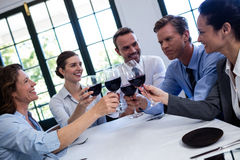 Group of businesspeople toasting wine glass during business lunch meeting Stock Images