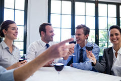Group of businesspeople toasting wine glass during business lunch meeting Royalty Free Stock Image